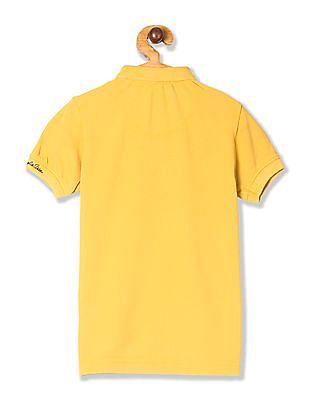 U.S. Polo Assn. Kids Yellow Boys Horse Print Pique Polo Shirt